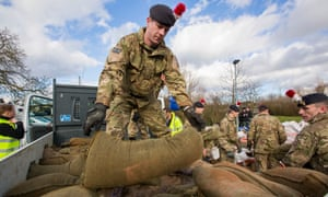 Soldiers unload sandbags after flooding in Wraybury in February 2014.