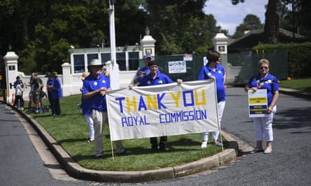 Members of the Care Leavers Australasia Network hold banners thanking the royal commission for its work.