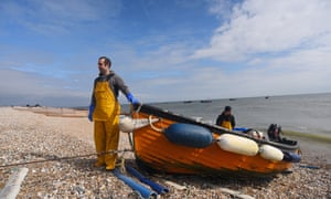 A fisherman hauls in his boat in Selsey, west Sussex.