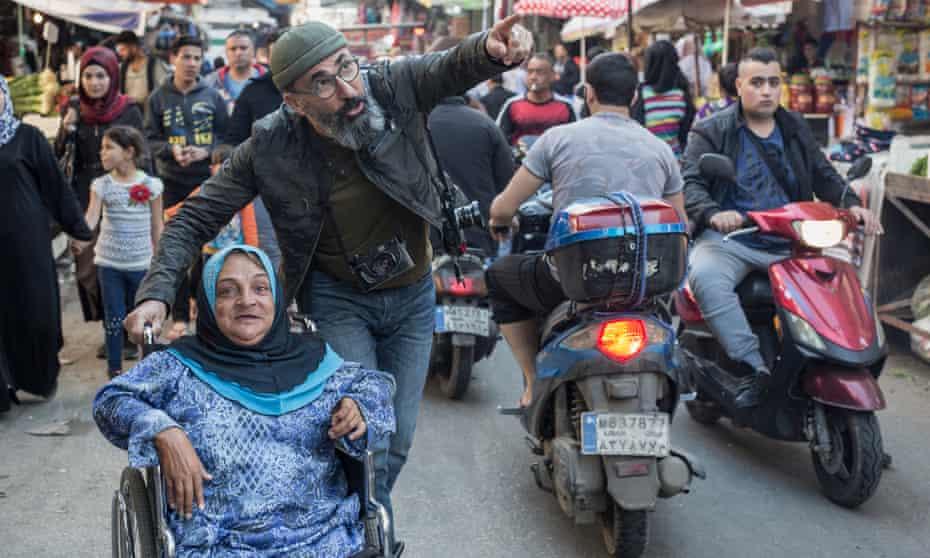 Maher Attar pushes Samar Baltaji in her wheelchair.