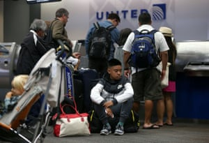 Passengers at a United Airlines ticket desk