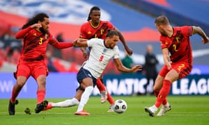 Dominic Calvert-Lewin takes on three Belgium playeers. The England forward's hold-up skills could make him a vital cog in England's machine.