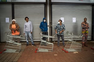 Residents of the Yeoville neighbourhood in Johannesburg wait to enter a grocery store on 3 April.