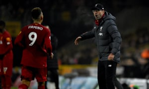 Roberto Firmino runs to Jürgen Klopp after scoring Liverpool's winner against Wolves.