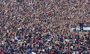 Basuki Tjahaja Purnama, also known as 'Ahok', and his deputy Djarot Saiful Hidayat stand in front of their supporters during campaigning in Jakarta.