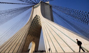 The Azadi tower strung with black flags.