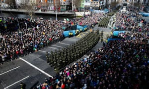 Thousands of members of the Irish armed forces and emergency services march down O'Connell Street in Dublin.