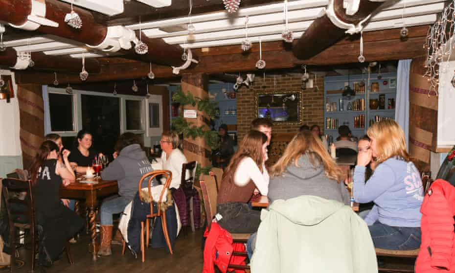 People enjoy drinks at the Mermaid pub on St Mary's on the Isles of Scilly.