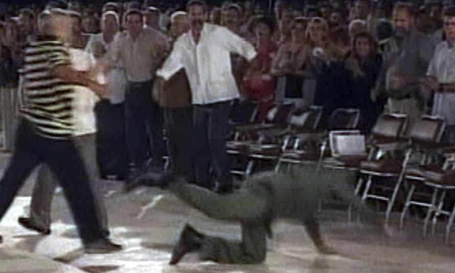 Castro falls badly after a speech in Santa Clara in 2004.