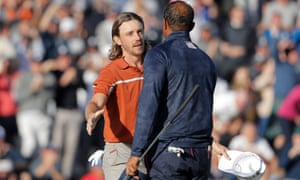 Tommy Fleetwood shakes hands with Tiger Woods after their foursomes match.