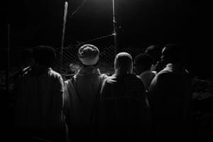 Pilgrims gather in front of mummified bodies while visiting Yemrehanna Kristos church in Lalibela, Ethiopia