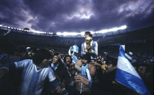 Argentina captain Daniel Passarella holds on to the trophy after the 1978 final.