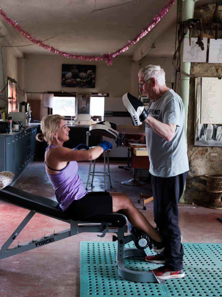 Peter Hill trains Gail Rozvaczy at his gym in Fryerstown, Victoria.