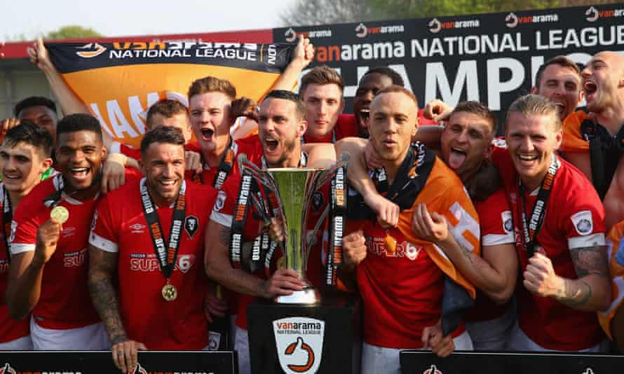 Salford City players celebrate winning the National League North and earning promotion to the fifth tier.