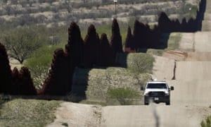 A border patrol agent patrols near Nogales, Arizona on 10 April 2018.