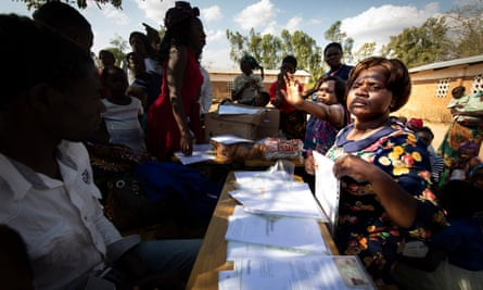 A team of paralegals and lawyers meet farmers to process claims