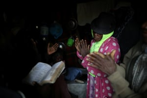 Believers gather to pray inside a house