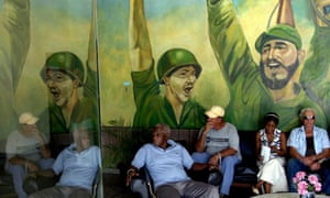 Paintings of Fidel Castro and his brother Raul on the wall in downtown Havana.