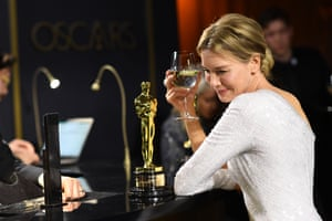 Renee Zellweger waits for her Oscar to be engraved at the Governors Ball.