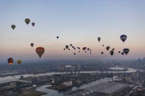 London, England: Hot-air balloons over the London skyline