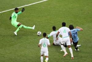 Uruguay's Edinson Cavani's shot is saved by Saudi keeper Mohammad Al-Owais.