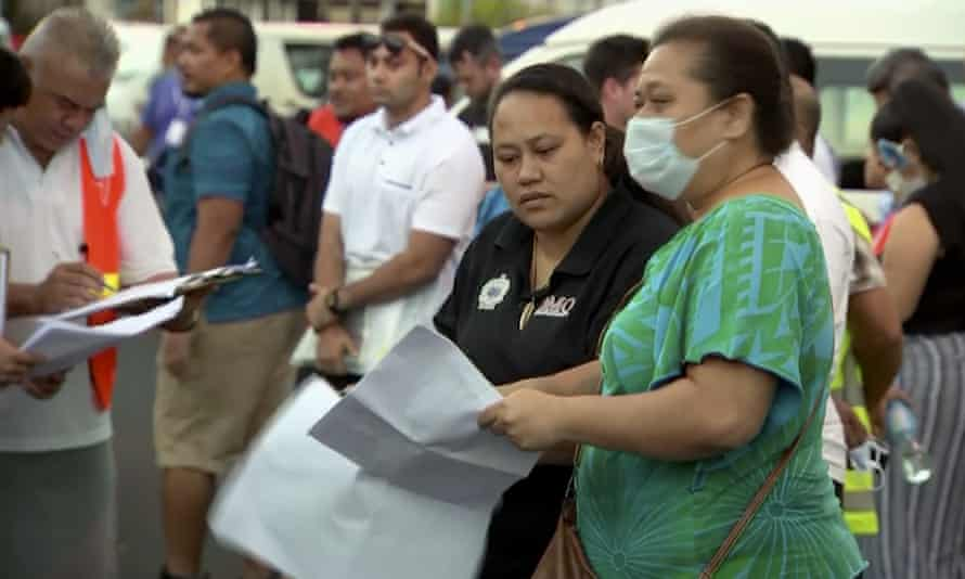 People gather outside a health emergency operation centre in the Samoan capital, Apia, as the government undertakes a measles vaccination drive.