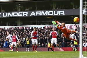 Harry Kane's curling shot flies past Arsenal goalkeeper David Ospina to give Spurs the lead.
