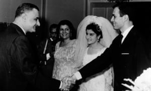 ** FILE ** Nineteen-year-old Mona Nasser, center, smiles up at her father, President Nasser of Egypt, left, as he shakes hands with his son-in-law, chemist Ashraf Marwan, right, during Ashraf's wedding to Nasser's daughter,  in a July 7, 1966 file photo. Mrs Nasser is also seen. Ashraf Marwan, the controversial son-in-law of Egypt's late President Gamal Abdel Nasser who was suspected of being an Israeli double agent, has died, a state-run news agency reported Wednesday, June 27, 2007. He was 62. (AP Photo/HO)