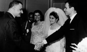 President Nasser of Egypt (left), shakes hands with Ashraf Marwan (right), during Marwan's wedding to Nasser's daughter, Mona (centre), on 7 July 1966.