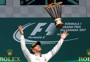 Hamilton celebrates winning the race on the podium.
