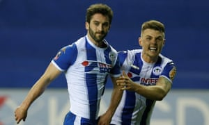 Wigan Athletic's Will Grigg celebrates with Max Power.