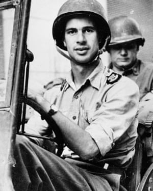 John Hersey driving a US army jeep in 1944.