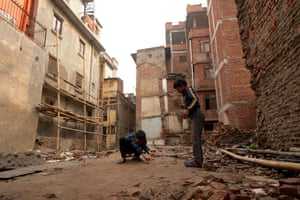 Children play in area where damaged buildings were destroyed in Kathmandu, Nepal