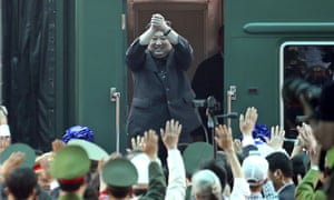 Kim Jong-un waves from his train as he arrives at the railway station in Vietnam, for a meeting with Donald Trump.
