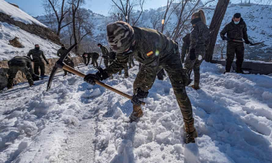 Spanish troops hep remove snow this week in Toledo, 45 miles south of Madrid, after Storm Filomena brought record snowfall.
