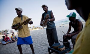The Makambele Brothers jamming by the shore during the Lake of Stars music festival.