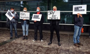 Demonstrators outside the courthouse in Frankfurt.