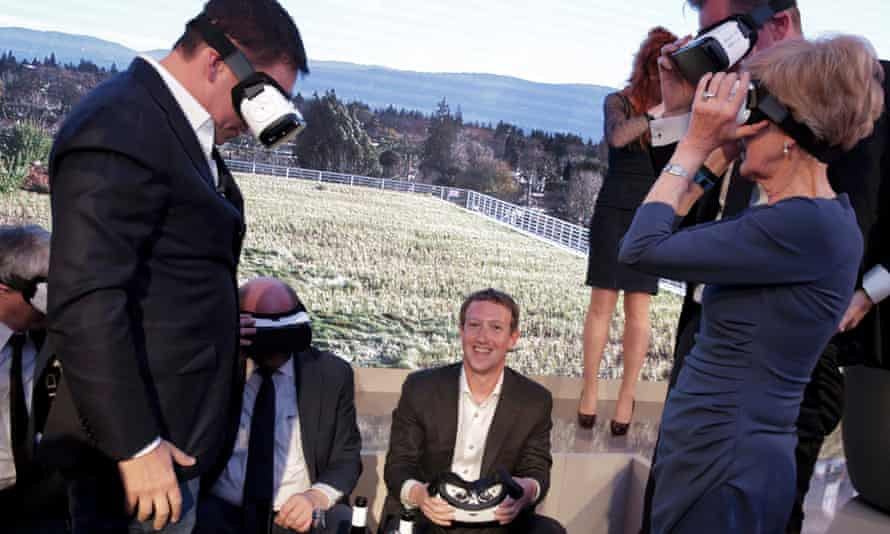 Facebook CEO Mark Zuckerberg and others use virtual reality headsets during an awards ceremony in Berlin, February 25, 2016.