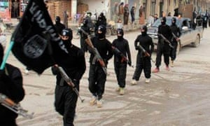 Islamic State militants marching in Raqqa, Syria.