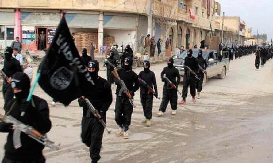 Islamic State fighters march in Raqqa, Syria