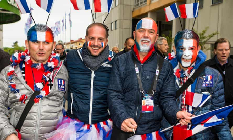 Four fans from France with foreheads or faces painted with the French flag
