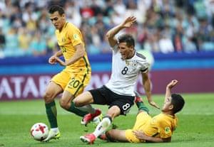 Germany's Leon Goretzka is taken out by Massimo Luongo.