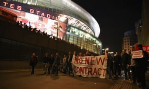 A group of Arsenal fans give their views on Wenger and his contract outside the stadium.