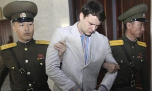 Otto Warmbier shown being escorted at the supreme court in Pyongyang in March 2016