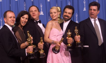 David Parfitt, Donna Gigliotti, Harvey Weinstein, Gwyneth Paltrow, Edward Zwick and Marc Norman celebrate after receiving the Oscar for best picture for Shakespeare In Love during the 71st annual Academy Awards in Los Angeles on 21 March 1999.