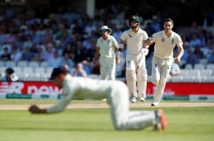 England's Chris Woakes looks on as Rory Burns takes a catch to dismiss Australia's Mitchell Marsh before the decision is overturned due to a no ball delivery.