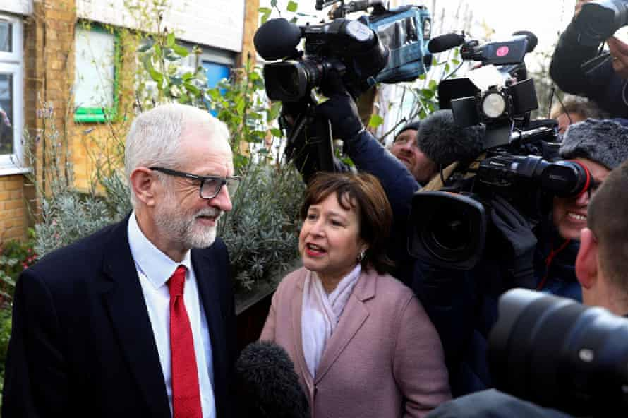 Jeremy Corbyn talks to members of the media outside his home on Friday.