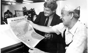 Peter Preston with a newly printed copy of the first Guardian front page.