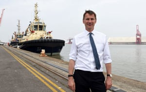 Jeremy Hunt posing in front of a big ship