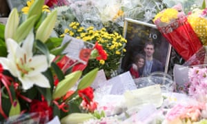 A photograph of Jo Cox and her husband Brendan sits among the floral tributes in the centre of Birstall.